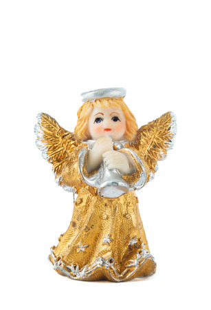 A little miniature statue of a colorful angel with wings and halo, playing the trumpet photo