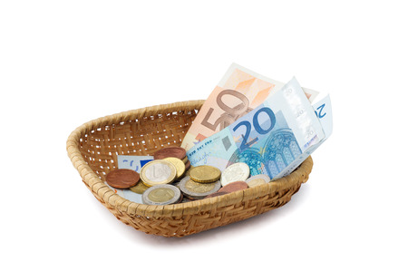 A little basket with money, making a collection during the Holy Mass Stock Photo