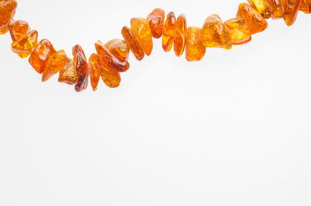 Orange natural amber necklace with space for copy text