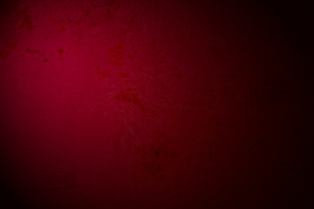 An antique dark red texture with light effect, to be used as with images or light colored text.
