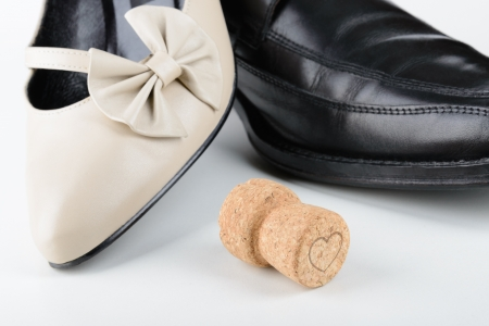 Male and female shoes with a Champagne cork, for Saint Valentine Day, the day of the lovers, or any holiday celebration photo