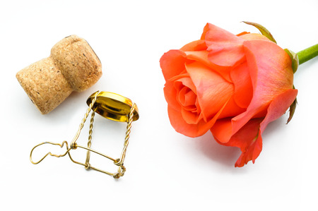 An orange rose and a Champagnes cork for Saint Valentine lovers celebration Stock Photo
