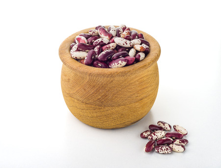 roman beans: Red Cannellini beans in a wooden bowl Stock Photo