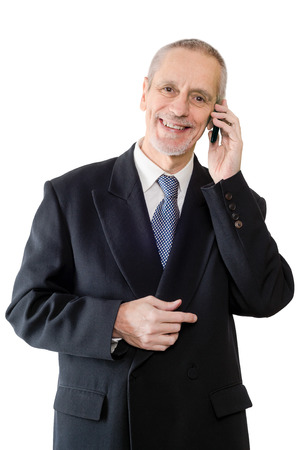neighbourly: An amiable businessman smiling on mobile phone
