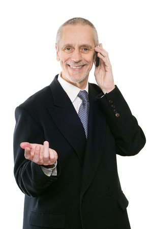 neighbourly: An agreeable businessman smiling on mobile phone