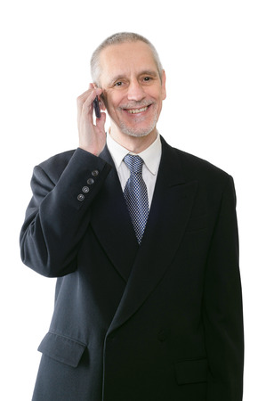neighborly: An amicable businessman smiling on mobile phone Stock Photo