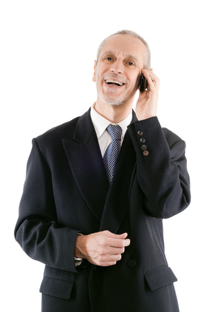 neighbourly: A friendly businessman smiling on mobile phone Stock Photo