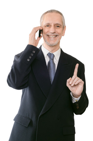 neighbourly: An handsome businessman smiling on mobile phone and showing the forefinger
