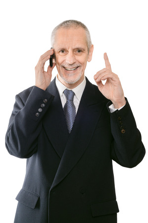 neighbourly: A pleasant businessman smiling on mobile phone and showing the forefinger Stock Photo