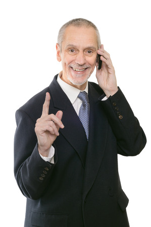 neighbourly: A gentle businessman smiling on mobile phone and showing the forefinger