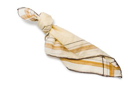 Een zakdoek met een knoop, om iets om niet te vergeten, op een witte achtergrond te onthouden
