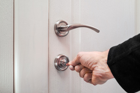 deadbolt: Opening or closing a safety lock on the toilet door