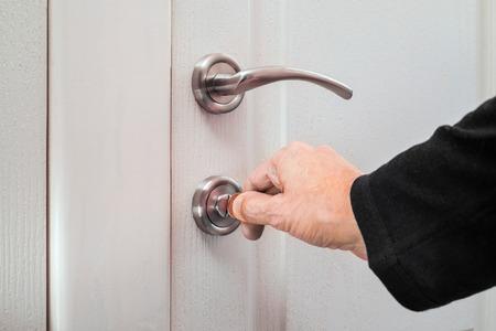 toilet door: Opening or closing a safety lock on the toilet door