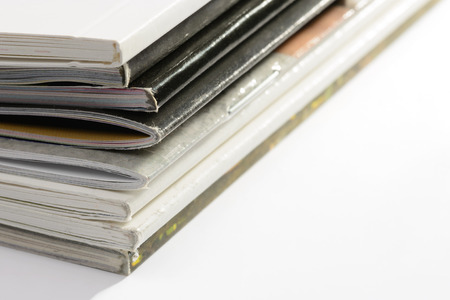 catalogs: A pile of different catalogs on white background Stock Photo