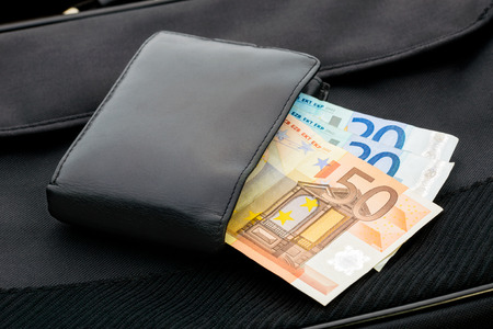 A black leather wallet with Euro banknotes