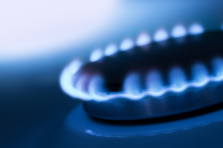 The blue flame from the burner of a gas stove 스톡 콘텐츠