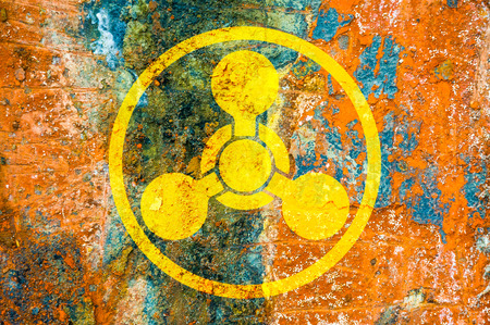 Chemical weapons symbol on a rust metal plate photo