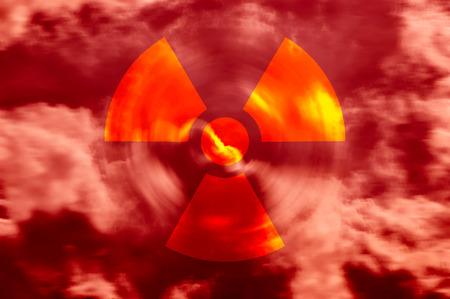 Radioactive symbol in a red sky with clouds photo