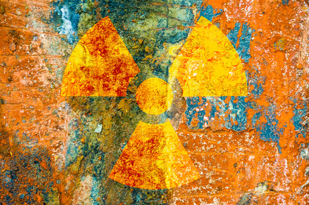 A ionizing radiation symbol on rust metal plate photo
