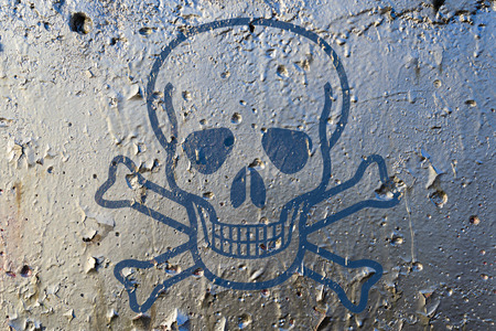 texturized: A skull as poison symbol on a silver paint texturized wall Stock Photo
