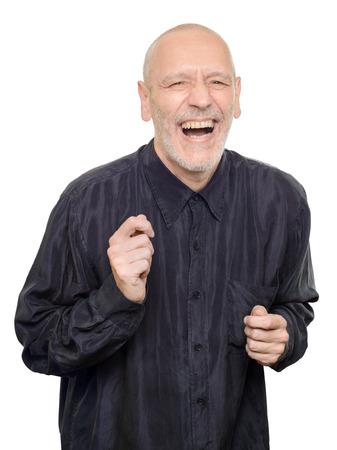 laughing out loud: Hombre con camisa de seda negro riendo a carcajadas, aislado en fondo blanco Foto de archivo