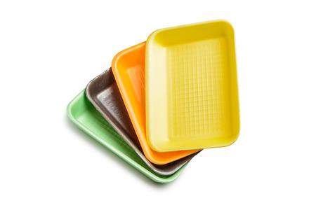 Group of four colored foam trays isolated on white background