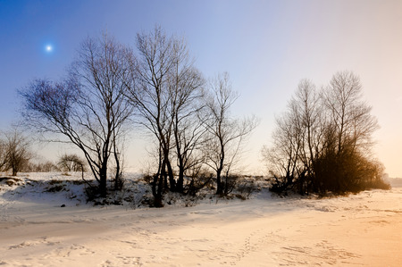 dnieper: Sunset with a star in the sky on the frozen Dnieper river covered by snow in winter