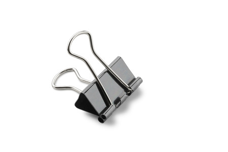 attach: A black clip to attach documents together, isolated on white background Stock Photo