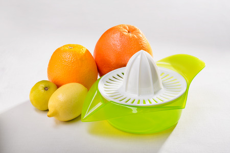 A citrus squeezer with lime, lemon, orange and grapefruit