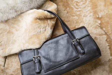 A black leather bag of warm blond sheepskin, blue fox and red sable mink furs photo
