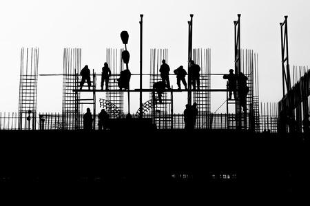 Werknemers op een gebouw in de bouw Stockfoto