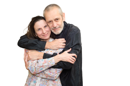 Happy mature man and woman smiling for S. Valentines day or anniversary and embracing each other. Isolated on white background. photo