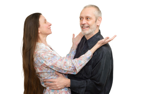 embracement: Mature man and woman with long hair looking at each other with love, eyes in eyes, for S. Valentines day or anniversary. Isolated on white background.