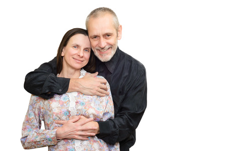 embracement: Happy mature man and woman smiling for S. Valentines day or anniversary and embracing each other. Isolated on white background. Stock Photo