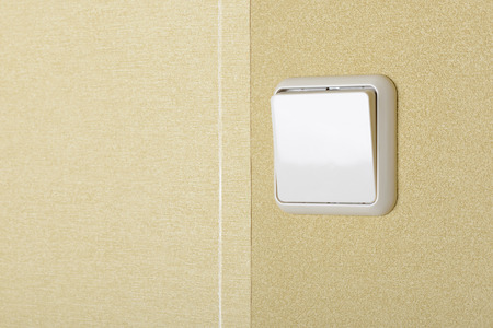 Big square electric interrupter on the wall photo