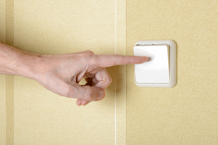 One finger switching, in or off, the light with a big square security electric interrupter photo