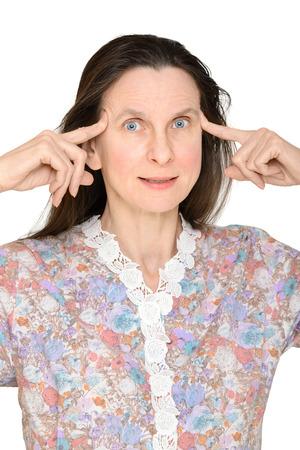 unbelievable: Una mujer adulta asombrado con los dedos en el templo, s�lo tiene una idea incre�ble Foto de archivo