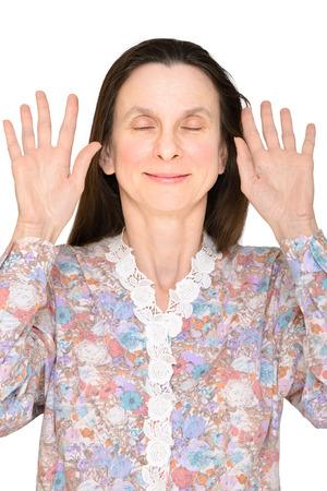 Smiling woman with closed eyes and open hands up showing the palms close to the face to express a lack of interest Stock Photo