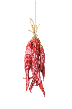 hanged: Hanged dry and sear hot red chili peppers isolated on white background Stock Photo