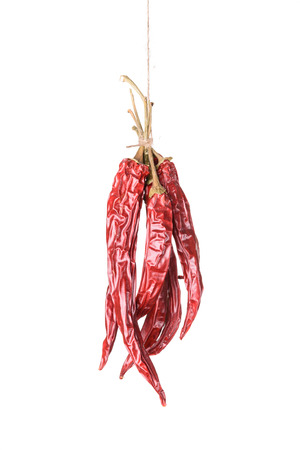 sear: Hanged dry and sear hot red chili peppers isolated on white background Stock Photo