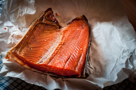 kamchatka: Smoked salmon from the Russian Kamchatka on white paper