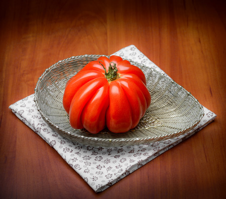 Nice Beef Heart tomato, Olena Ukraina, shown in a silver filigree basket, like a gem from nature photo