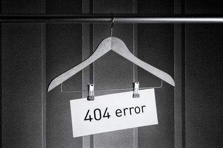 Black and white image of a hanger with a tag on which it is written 404 error