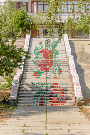 raiser: KievUkraine - July 29, 2015: Stairs with red flowers painted on the step raisers to create a flat effect with the distance.