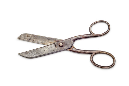Big old rust iron scissors isolated on white background