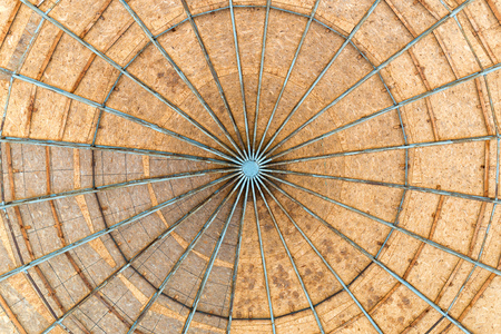 rafters: A dome made with Oriented Strand Board wood, also called OSB, with a metallic structure seen from below