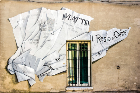 Saludecio/Italy - March 15, 2005: A mural painting in Saludecio illustrating  the daly paper