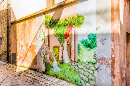 wistaria: SaludecioItaly - March 15, 2005: A mural painting in Saludecio showing a nice garden with wistaria Editorial