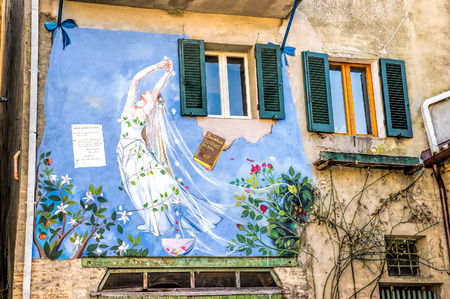 mal: SaludecioItaly - March 15, 2005: A mural painting in Saludecio illustrating the publication of the book Les Fleurs du mal (The Flowers of Evil) by the French author Charles Baudelaire in 1857 Editorial