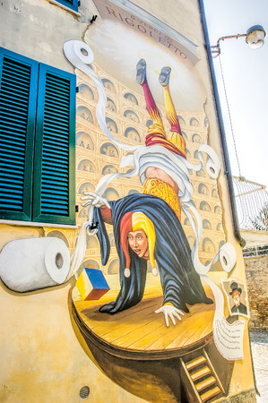 verdi: SaludecioItaly - March 15, 2005: A mural painting in Saludecio illustrating the invention of the hygienic toilet paper by the American Joseph Gayetty in 1857. On the illustration the clown from the Verdi opera Rigoletto
